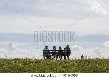 Family Resting On Dike