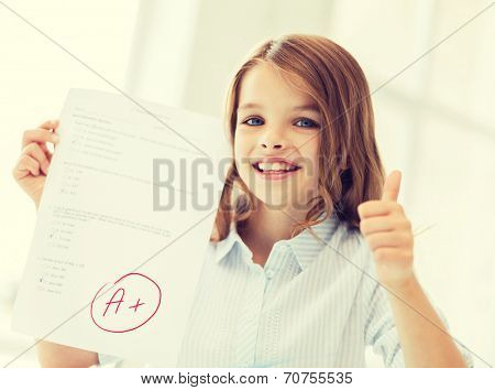 education and school concept - little student girl with test and A grade at school showing thumbs up