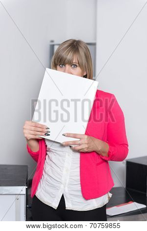 Woman Is Looking From Behind A File