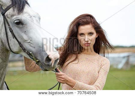 woman long hair kissing beautiful horse
