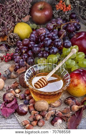 Autumn fruits and honey