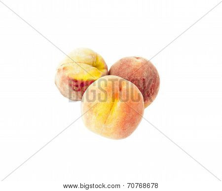 Three Ripe peaches with fluff plucked from the tree isolated over white background