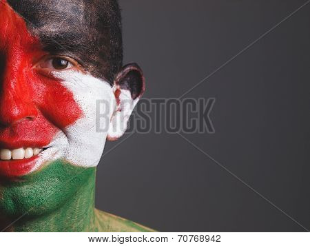 Man And His Face Painted With Palestine Flag