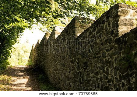 Old stone wall bordering the park