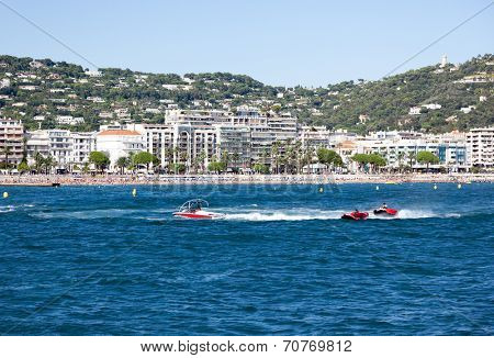 Watersport: people having fun on towables pulled by a motorboat. Cannes, French Riviera, France, Europe.