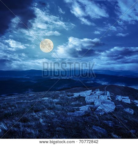 Stones On Top Of The Mountain Range At Night