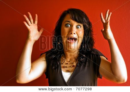 Young Attractive Woman Surprised And Scared