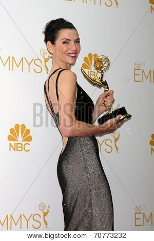 LOS ANGELES - AUG 25:  Julianna Margulies at the 2014 Primetime Emmy Awards - Press Room at Nokia Theater at LA Live on August 25, 2014 in Los Angeles, CA