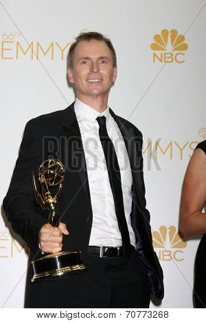LOS ANGELES - AUG 25:  Phil Keoghan at the 2014 Primetime Emmy Awards - Press Room at Nokia Theater at LA Live on August 25, 2014 in Los Angeles, CA