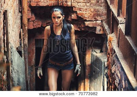 sexy soldier woman on factory ruins
