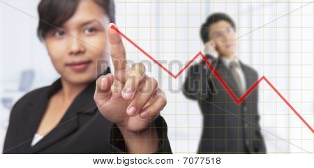 Asian Businesswoman Pointing Graph
