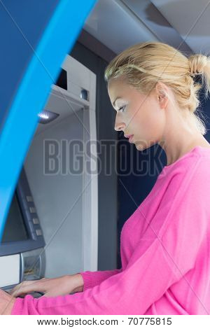 Lady using an atm counter