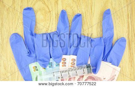 Big Plastic Syringe On Bill And Gloves