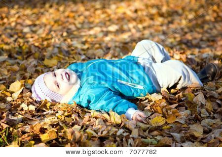 Children Throw Autumn Leaves