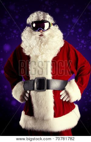 Santa Claus is standing in the ski mask. Christmas.