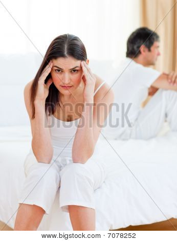 Sad Couple Sitting Sitting Separately After Having A Row