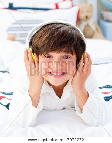 Happy Little Boy Listening Music With Headphones On
