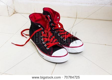 canvas shoes with dazzling red colour laces on an isolated background