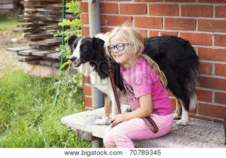 Girl With Border Collie Dog On Farm