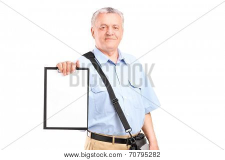Mature mailman holding a clipboard isolated on white background