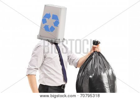 Man with a recycle bin over his head carrying a garbage bag isolated on white background