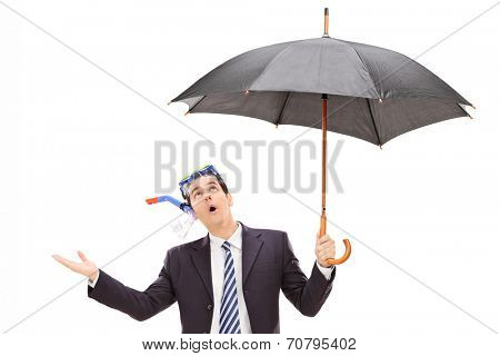 Businessman with diving mask holding an umbrella isolated on white background