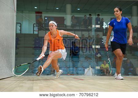 AUGUST 19, 2014 - KUALA LUMPUR, MALAYSIA: Deon Saffery rushes forward to return the ball in her match against Omneya Kawy in the CIMB Malaysian Open Squash Championship 2014.
