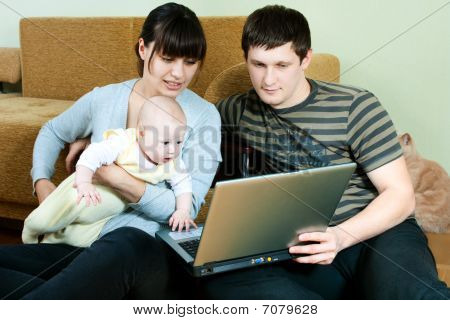 Happy Family With Laptop