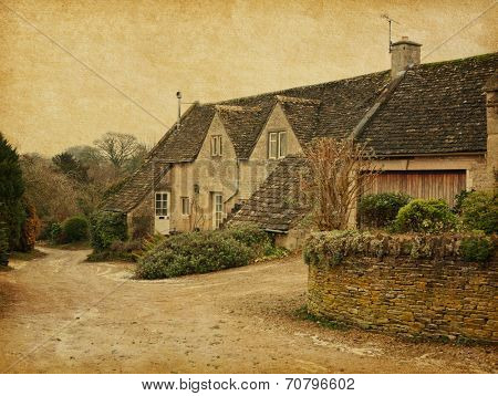 Old  house in Bibury, Gloucestershire, England, UK. Photo in retro style. Paper texture.