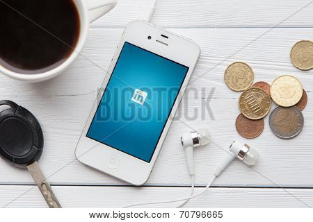 WROCLAW, POLAND - JULY 31, 2014: Photo of iPhone 4 smartphone device with Linkedin app running - a social network for professionals