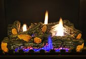 image of cozy hearth  - Close up of logs in gas fireplace - JPG
