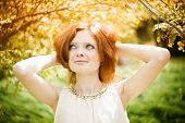 picture of freckle face  - Portrait of redhead girl with blue eyes on nature - JPG