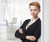 pic of space suit  - Young caucasian attractive businesswoman standing arms crossed at business office - JPG