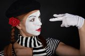 image of clown rose  - Portrait of a mime comedian on black background - JPG