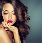 image of long nails  - Model with beautiful curly hair - JPG