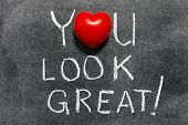 picture of you are awesome  - you look great exclamation handwritten on blackboard with heart symbol instead of O - JPG