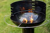 image of barbie  - Empty barbecue with charcoal lit up  - JPG