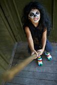 stock photo of antichrist  - Portrait of eerie girl with broom - JPG