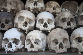 stock photo of morbid  - Stacked human skulls at the Killing Fields of Choeung Ek Cambodia - JPG