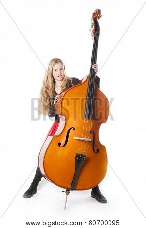Young Blond Girl Stands Behind Double Bass In Studio