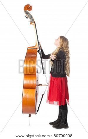 Young Blond Girl Looks Up To Double Bass In Studio