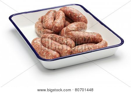 raw sausage in butcher tray isolated on white background