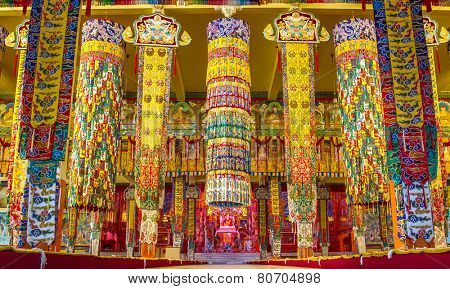 BYLAKUPPE, INDIA - FEBRUARY 10: Brightly decorated Buddhist temple in Namdroling Monastery in Bylakuppe, Karnataka, India on February 10, 2013
