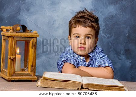 little boy with book and lanterns, symbol of education, school reform, learning