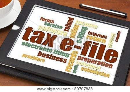 tax electronic filing concept - a word cloud on a digital tablet with a cup of tea