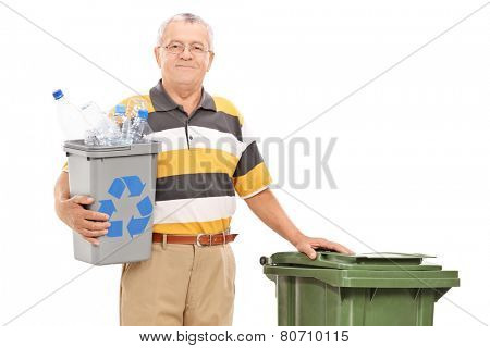 Senior holding recycle bin and standing by trash can isolated on white background