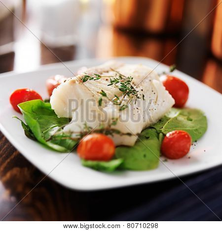 halibut with spinach, cherry tomatoes and thyme