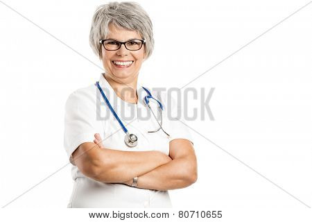 Happy old female doctor with hands folded, isolated on white