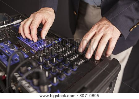 disc jockey's hands on control board