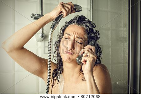 Talking on the phone in the shower